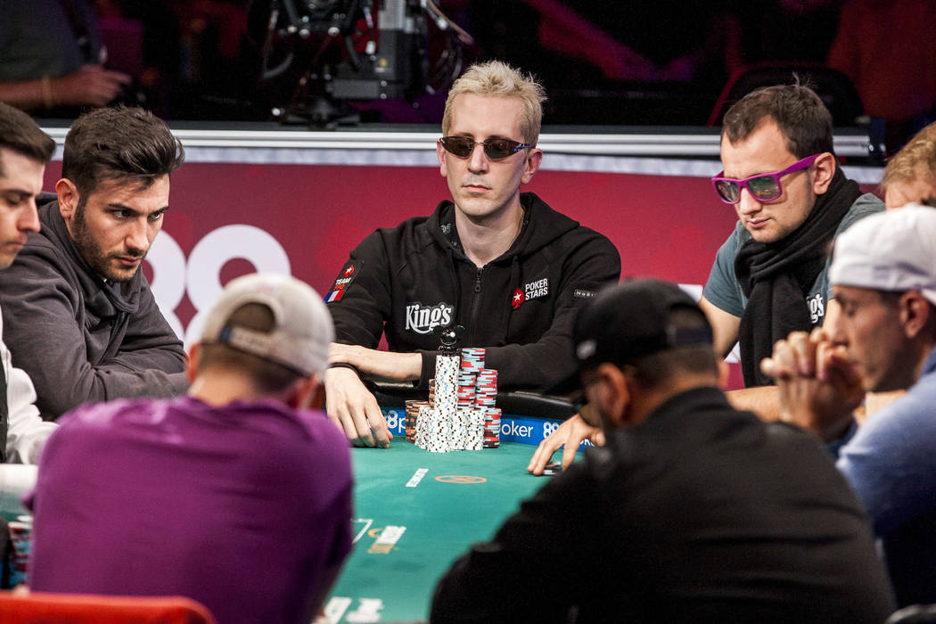 """Players including Bertrand """"ElkY"""" Grospellier, center, compete in the World Series of Pokerճ $111,111 buy-in High Roller for One Drop No-limit Holdեm tournament at th ..."""