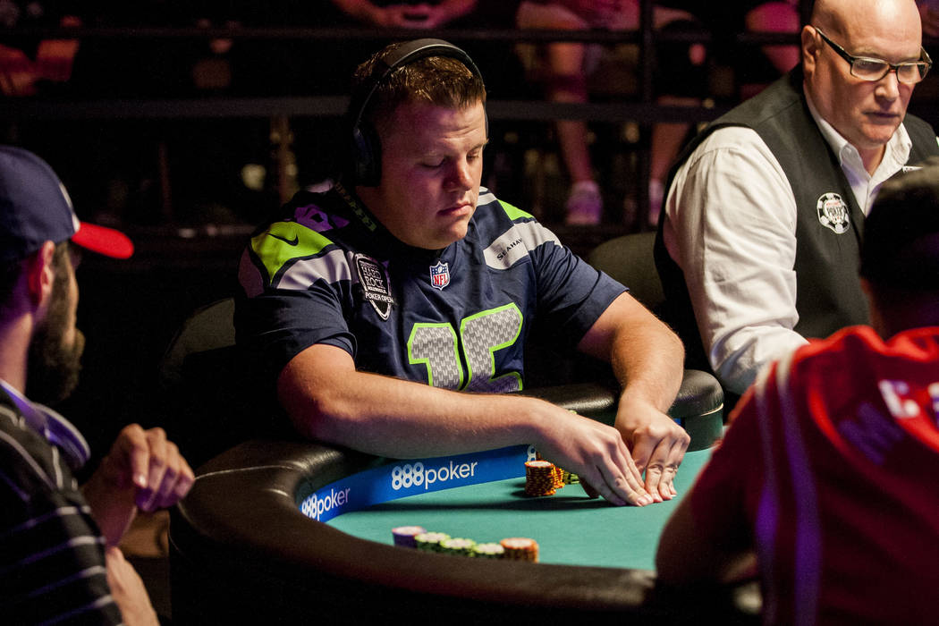 Matt Affleck looks at his card at the final table of the Colossus III - $565 No-Limit Hold'em tournament at the World Series of Poker on Wednesday, June 7, 2017.  Patrick Connolly Las Vegas Review ...
