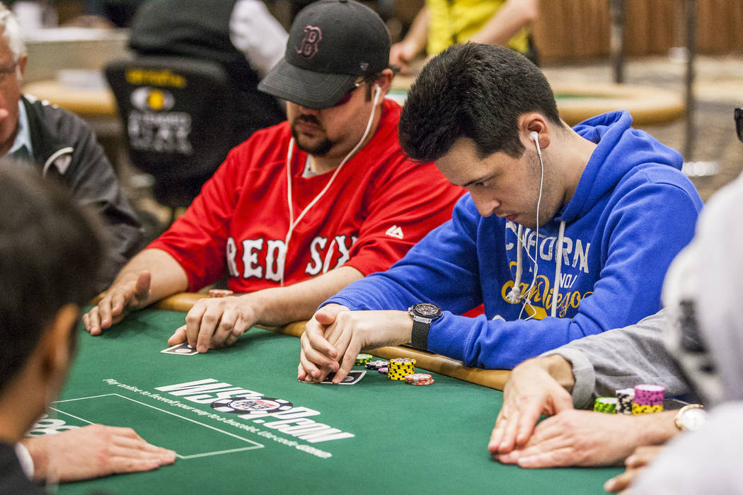 Adrián Mateos looks at his hand in The Marathon - $2,620 No-Limit Hold'em event during the World Series of Poker at the Rio Convention Center on Monday, June 12, 2017.  Patrick Connolly Las V ...