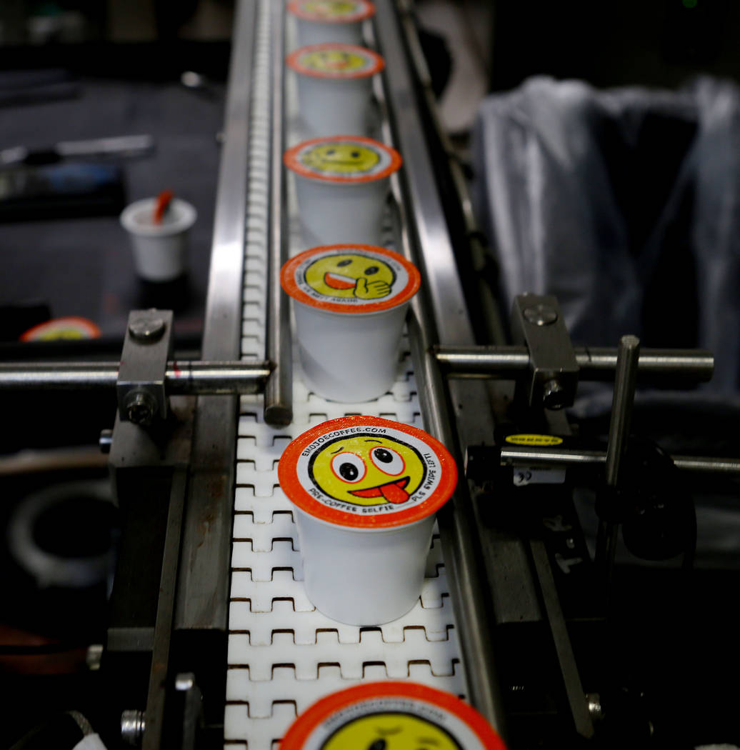 Stella Brands Packing and Printing owner Brent Patterson's original designed emoji single serve coffee cups are produced in his company's warehouse in Las Vegas, Tuesday,  May 30, 2017.  Elizabeth ...