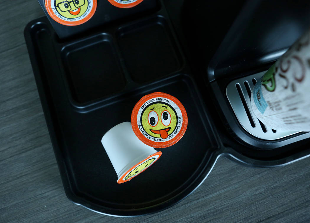 Stella Brands Packing and Printing owner Brent Patterson's original designed emoji single serve coffee cups in his company's warehouse in Las Vegas, Tuesday,  May 30, 2017.  Elizabeth Brumley/Las  ...