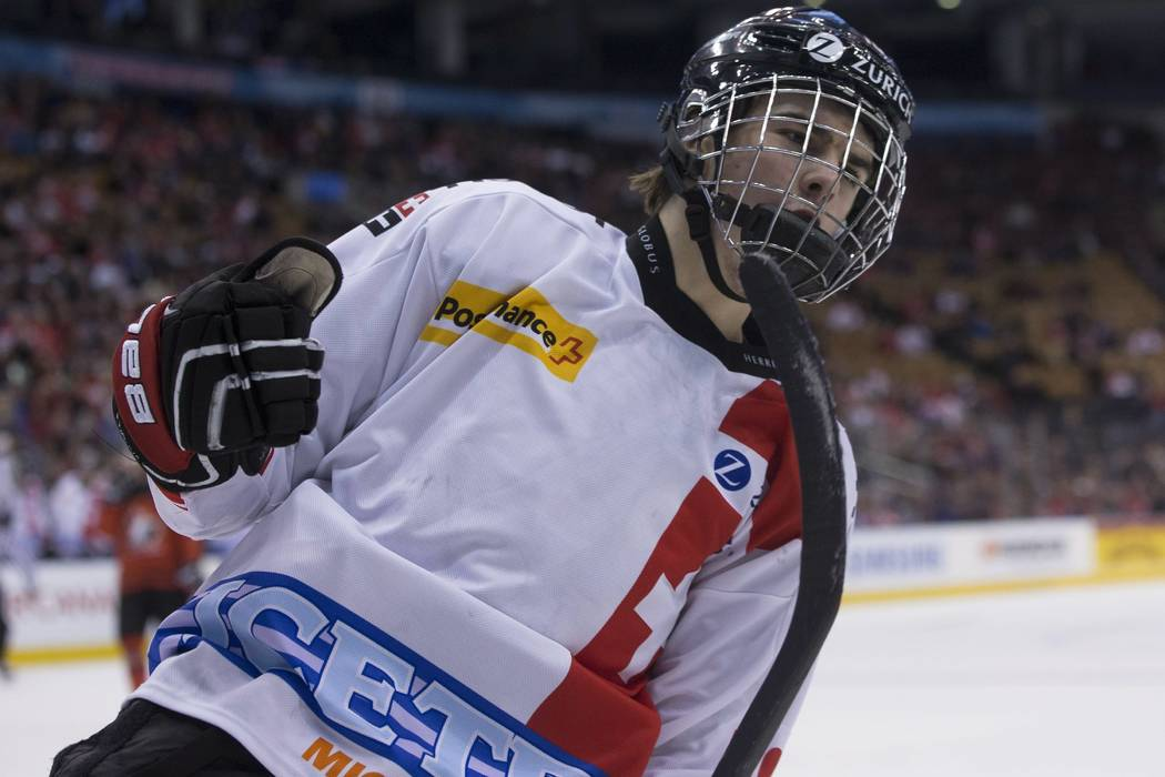 Switzerland's Nico Hischier celebrates a goal against Canada during the second period of an exhibition game ahead of the IIHF World Junior hockey championships, in Toronto on Friday, Dec. 23, 2016 ...