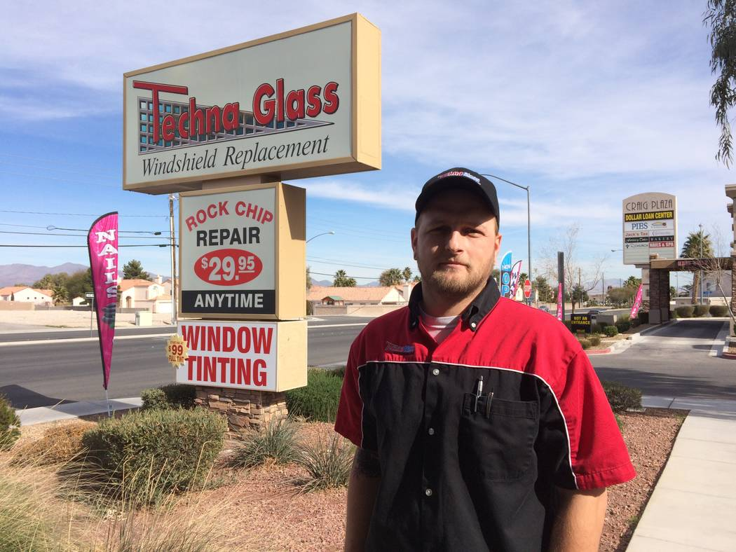 Tristan Barnes, store manager for TechnaGlass, 2515 W. Craig Road, talks Jan. 30, 2017, about how many customers he sees each week who need windshield repairs after rocks kicked up by other vehicl ...