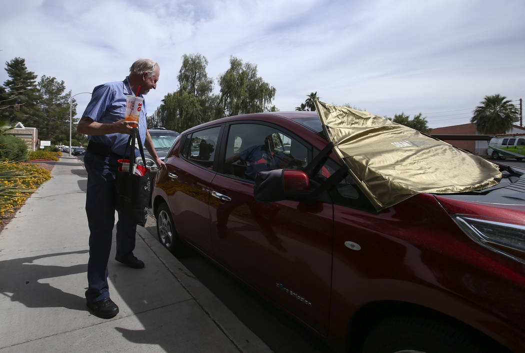 Lloyd Reece, president of the Las Vegas Electric Vehicle Association, next to his 2011 Nissan Leaf in Las Vegas on Wednesday, May 31, 2017. Chase Stevens Las Vegas Review-Journal @csstevensphoto