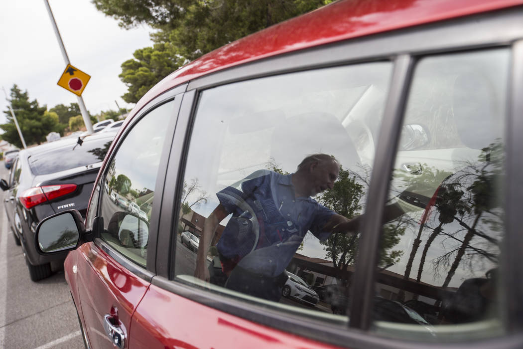 Lloyd Reece, president of the Las Vegas Electric Vehicle Association, is reflected in his 2011 Nissan Leaf in Las Vegas on Wednesday, May 31, 2017. Chase Stevens Las Vegas Review-Journal @cssteven ...