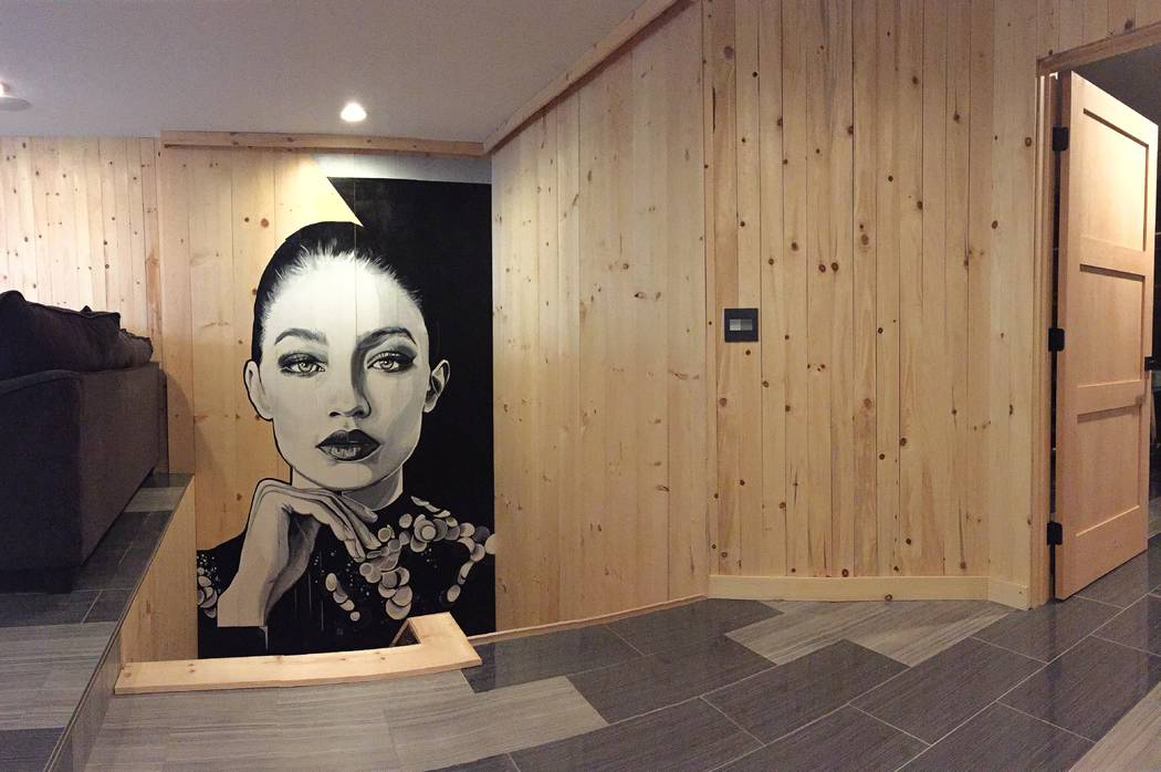Mallory Dawn Artist Mallory Dawn painted this large portrait of model Gigi Hadid in a client's home.