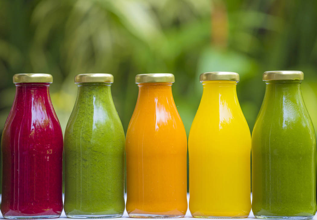 Organic cold-pressed raw vegetable juices. Thinkstock