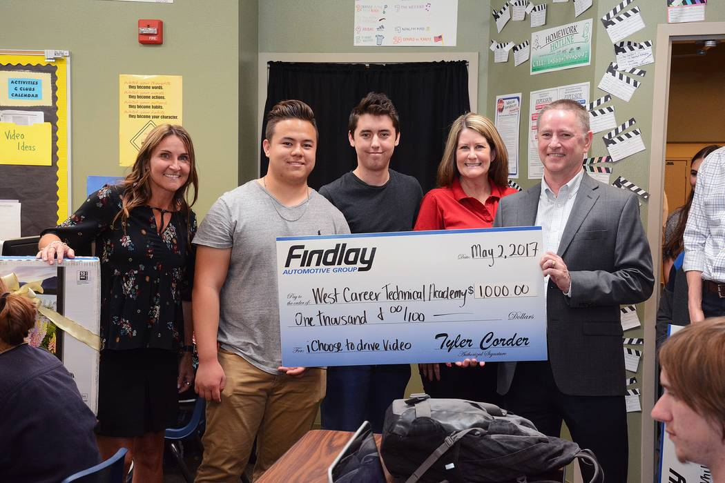 Findlay Auto The fourth annual iChoose to Drive safe driving campaign has been completed. Findlay Automotive Group CFO Tyler Corder, right, presents the winning check to, from left, Kip Sweikert,  ...