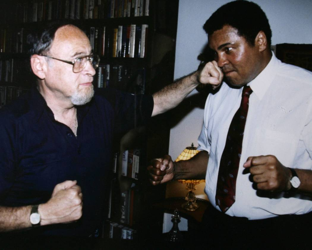 "Hall of Fame boxing writer Jerry Izenberg is shown with Muhammad Ali in 1991. Izenberg, who lives in Henderson, has written a book called ""Once There Were Giants"" about the golden era of boxing's  ..."