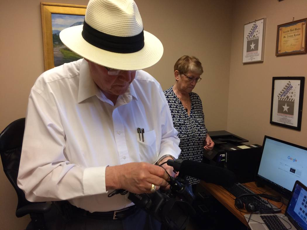 Art Martini, director of photography, fires up a video camera May 23, 2017, as Temma Hammond, behind him, brings up information on her computer. Hammond is a Sun City Summerlin resident, a  vetera ...