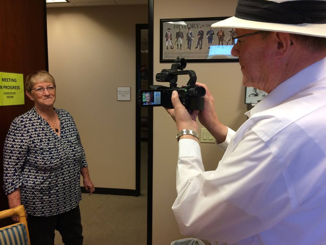 Temma Hammond, president of Media Data Network, pauses May 23, 2017, as Art Martini, director of photography, frames her in the viewfinder of his camera. Their pair, along with Steve Coryell, are  ...