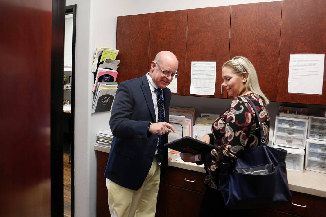 Internist Dr. Ivan Goldsmith, left, and Tiffany Krentz with Synergy Pharmaceuticals discuss a new product at Goldsmith's Las Vegas office,Thursday, May 31, 2017.  Elizabeth Brumley/Las Vegas Revie ...