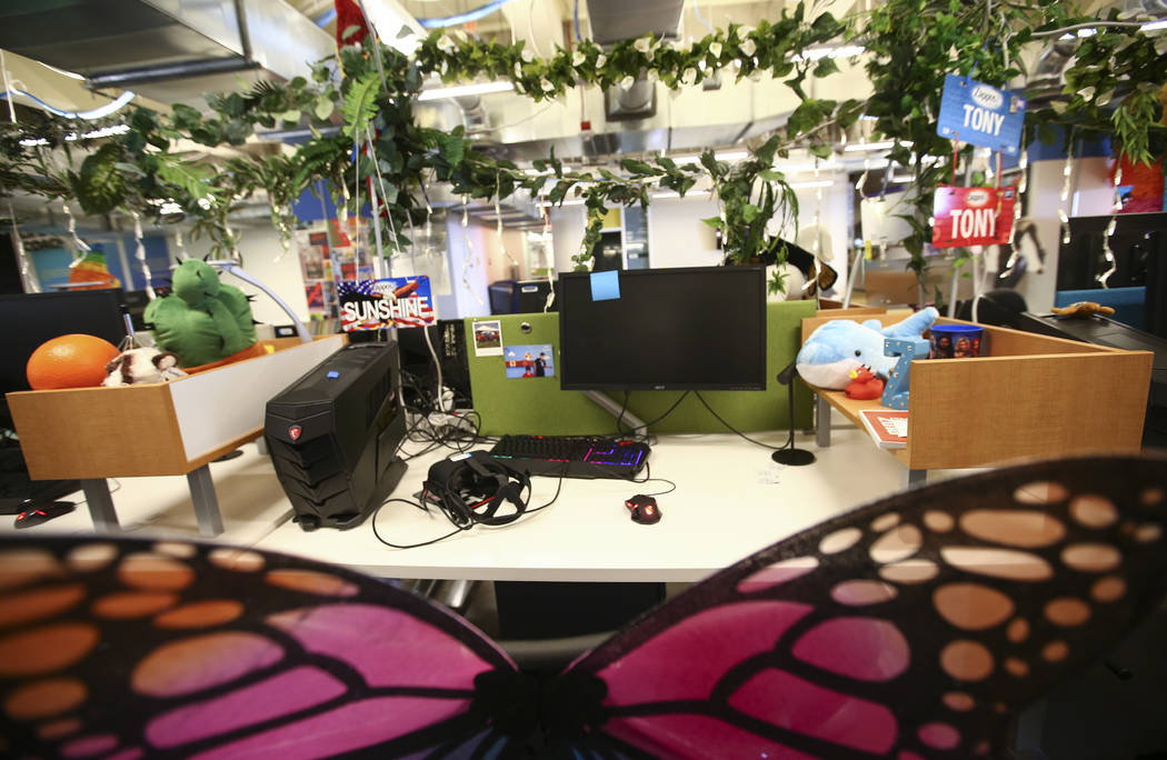 Call center desks with a virtual reality headset offer visitors a unique experience as part of the tour at Zappos headquarters in downtown Las Vegas on Thursday, June 1, 2017. Chase Stevens Las Ve ...