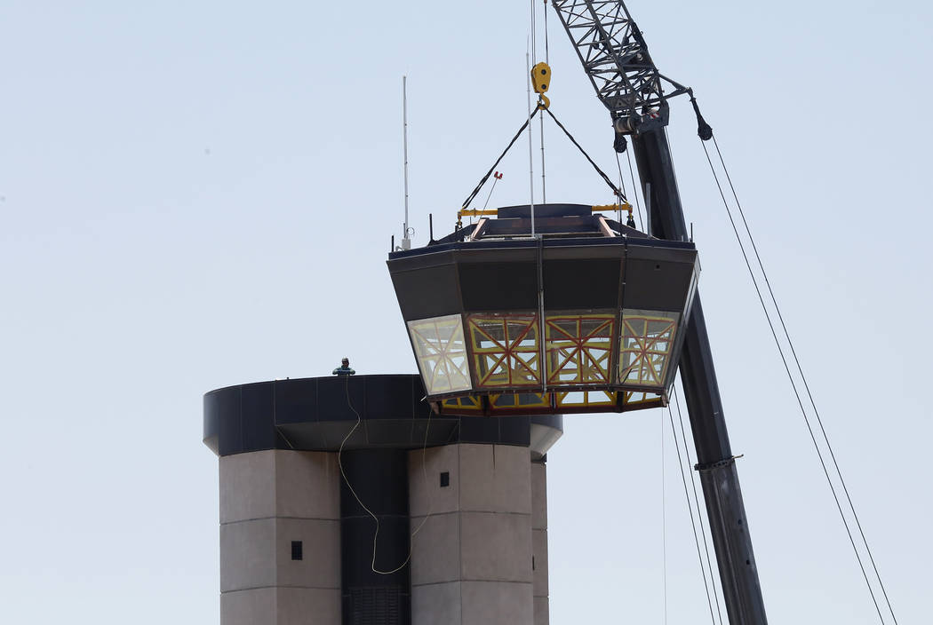 Workers lift a 525-square-foot cab from the top of the former air traffic tower at McCarran International Airport on Friday, June 2, 2017, in Las Vegas. Bizuayehu Tesfaye Las Vegas Review-Journal  ...