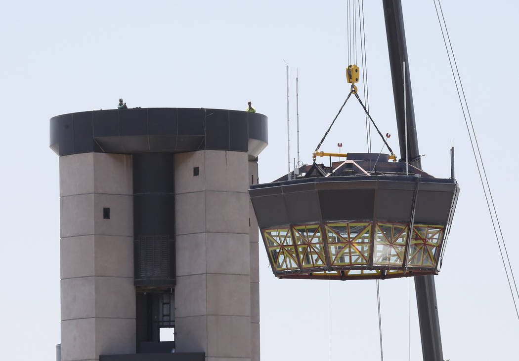 Workers take down a 525-square-foot cab from the top of the former air traffic tower at McCarran International Airport on Friday, June 2, 2017, in Las Vegas. Bizuayehu Tesfaye Las Vegas Review-Jou ...