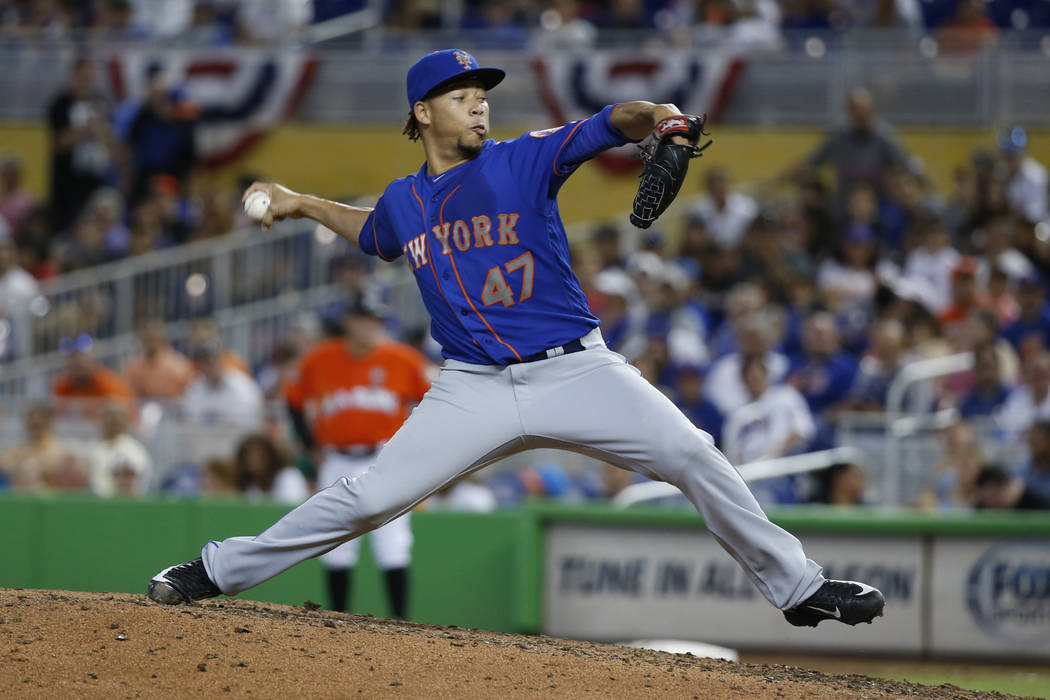 New York Mets' Hansel Robles delivers a pitch during the eighth inning of a baseball game against the Miami Marlins, Sunday, April 16, 2017, in Miami. The Marlins defeated the Mets 4-2. (AP Photo/ ...
