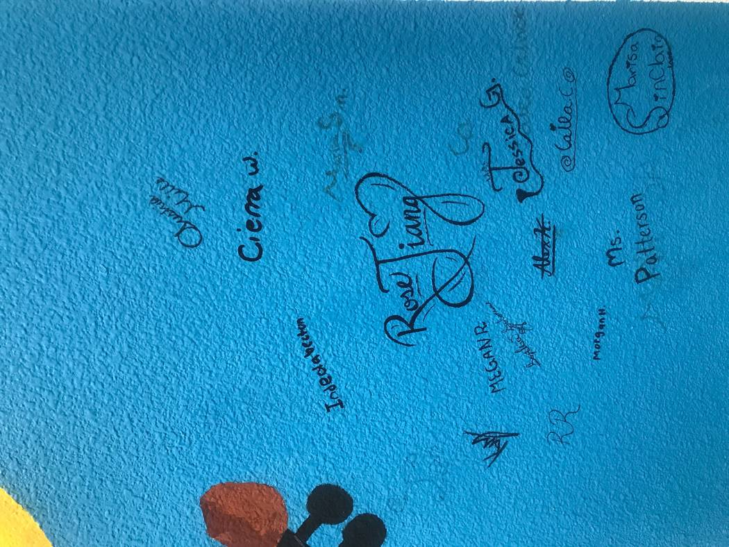 Students in Delaney Patterson's art club signed their names on a mural that they designed and painted in a hallway at Brian and Teri Cram middle school, 1900 Deer Springs Way. Kailyn Brown/View
