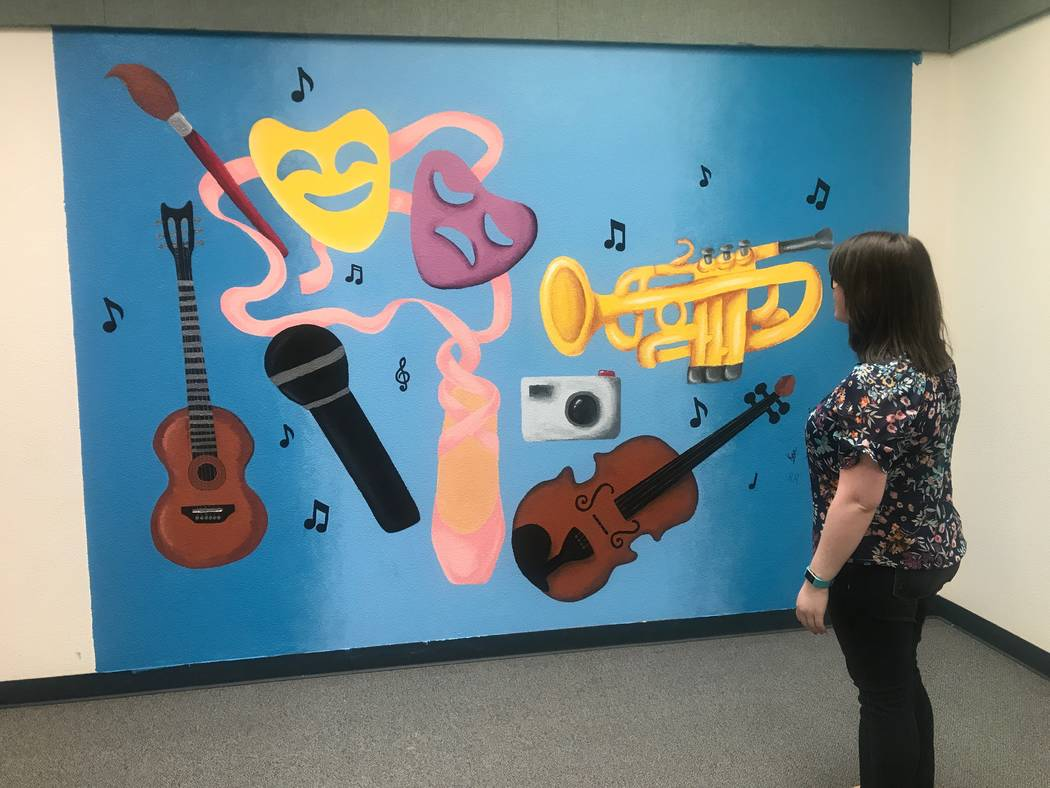 Delaney Patterson, art and photography teacher, looks at mural that her art club students created May 30 at Brian and Teri Cram middle school, 1900 Deer Springs Way. Kailyn Brown/View