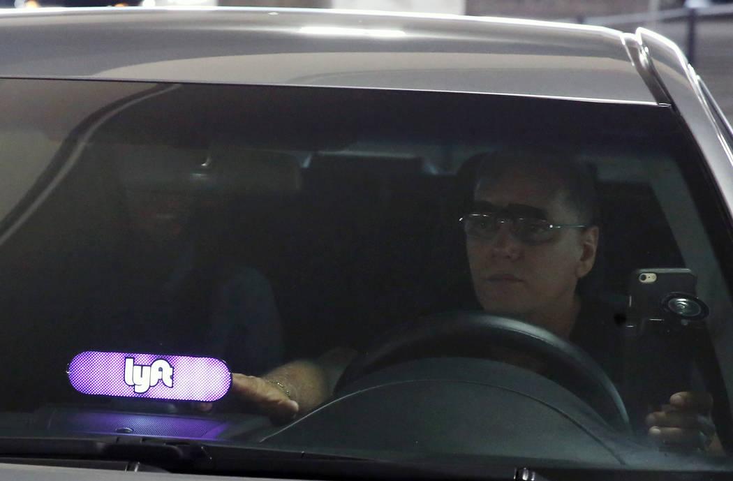 A driver displaying Lyft sign on his dashboard picks up his passenger from McCarran International Airport at Terminal 1 on Thursday, June 1, 2017, in Las Vegas. Bizuayehu Tesfaye Las Vegas Review- ...