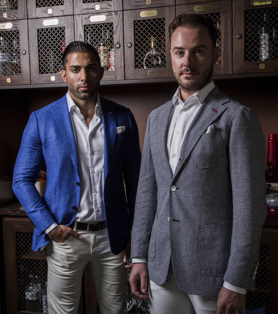 Brent Marks, left, and Brooks Smith model suits in the store's lounge. The lockers belong to members of Stitched's inner circle — they are gifted to loyal patrons and longtime supporters. Sh ...