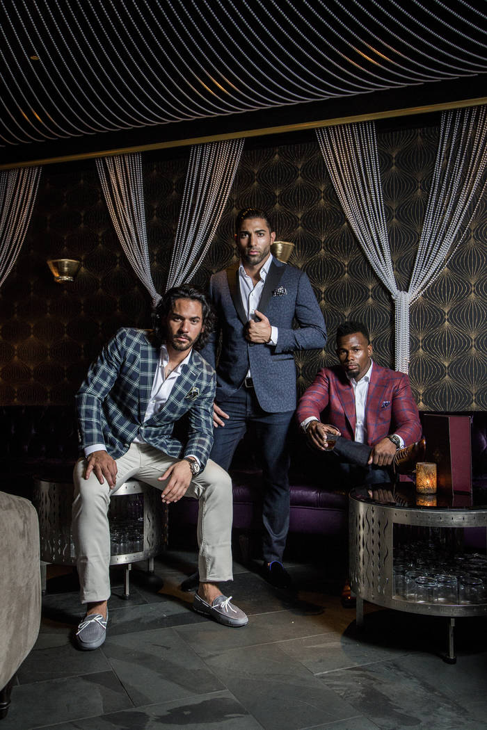 Jason Craig, from left, Brent Marks and Jai Shaun White model sport coats from Stitched's XXXX Collection Black Label at Beauty and Essex for a recent lookbook. Shane O'Neal.