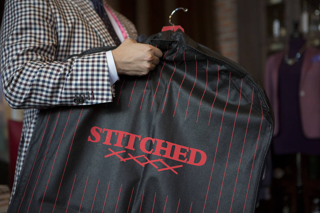 Stitched general manager Ricci Lopez holds up a garment bag at Stitched located in Cosmopolitan hotel-casino on Thursday, June 1, 2017 in Las Vegas. Bridget Bennett Las Vegas Review-Journal @bridg ...