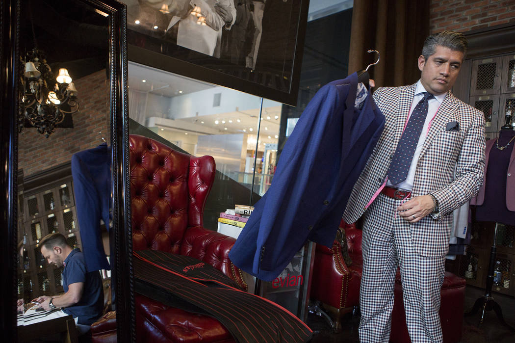Stitched general manager Ricci Lopez holds up a garment to show customer Matt Welebir the material at Stitched located in Cosmopolitan hotel-casino on Thursday, June 1, 2017 in Las Vegas. Bridget  ...
