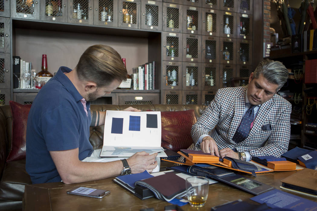 Stitched general manager Ricci Lopez, right, works with customer Matt Welebir, left, as he chooses fabric for a custom tuxedo at Stitched located in Cosmopolitan hotel-casino on Thursday, June 1,  ...