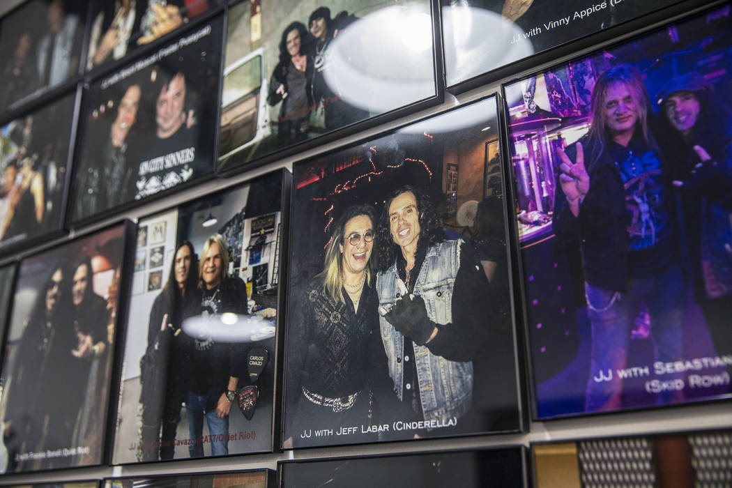 Barber J.J. Jones' Las Vegas salon is covered with photos he's taken with his favorite hair metal rockstars over the years. Photo taken on Wednesday, May 31, 2017, at Jones' salon, in Las Vegas. B ...