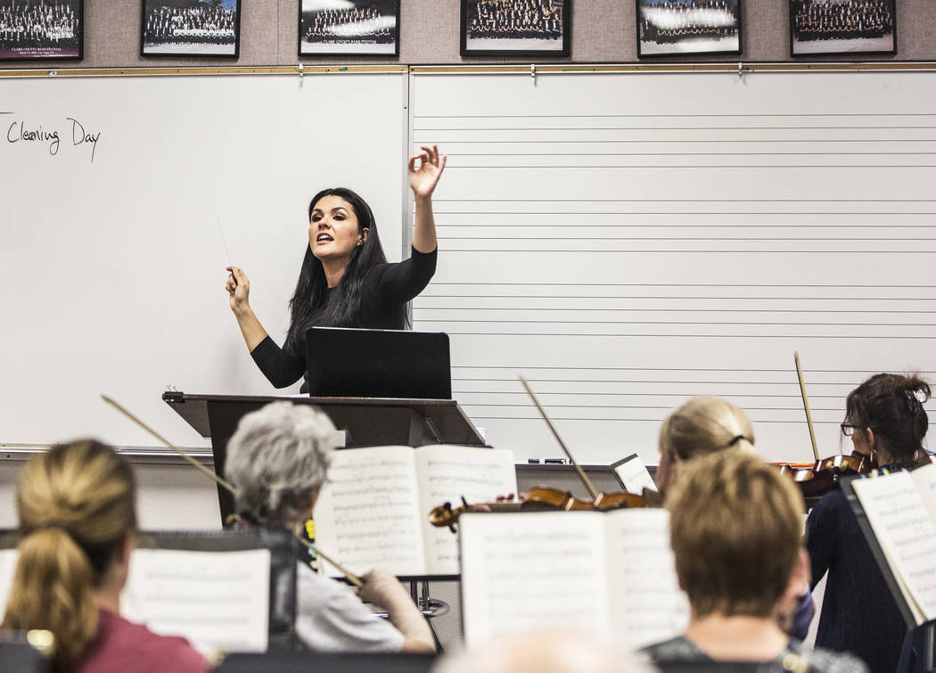 Conductor Alexandra Arrieche leads the Henderson Symphony Orchestra during rehearsal for the annual silent movie concert on Tuesday, May 30, 2017, at Greenspun Junior High School, in Henderson. Be ...