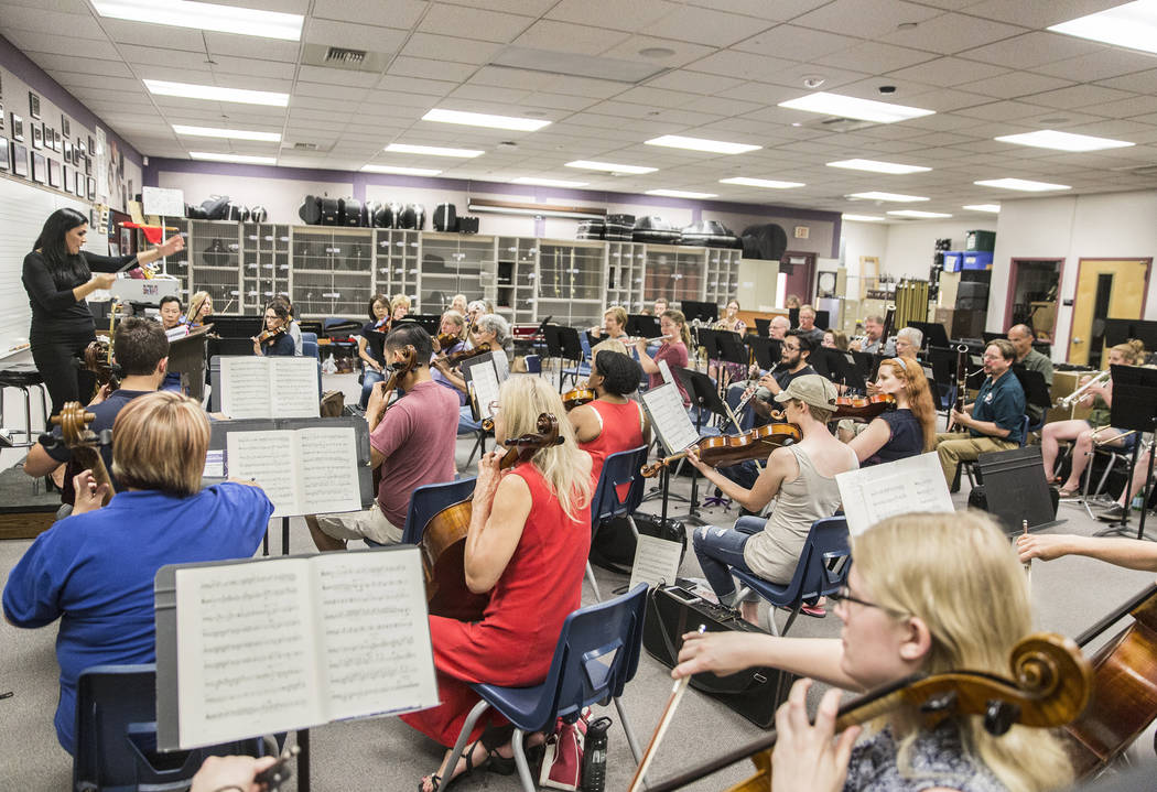 Conductor Alexandra Arrieche, left, leads the Henderson Symphony Orchestra during rehearsal for the annual silent movie concert on Tuesday, May 30, 2017, at Greenspun Junior High School, in Hender ...