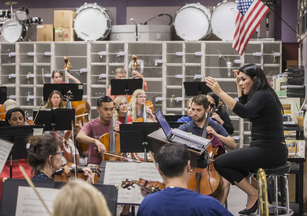 Conductor Alexandra Arrieche, right, leads the Henderson Symphony Orchestra during rehearsal for the annual silent movie concert on Tuesday, May 30, 2017, at Greenspun Junior High School, in Hende ...