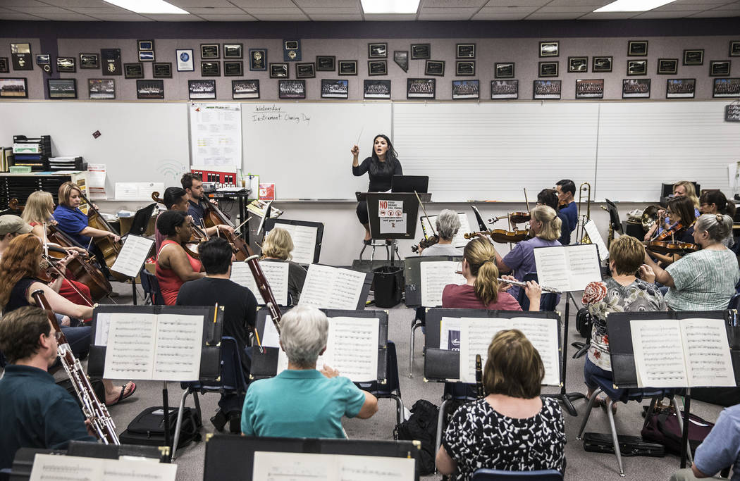 Conductor Alexandra Arrieche, middle, leads the Henderson Symphony Orchestra during rehearsal for the annual silent movie concert on Tuesday, May 30, 2017, at Greenspun Junior High School, in Hend ...