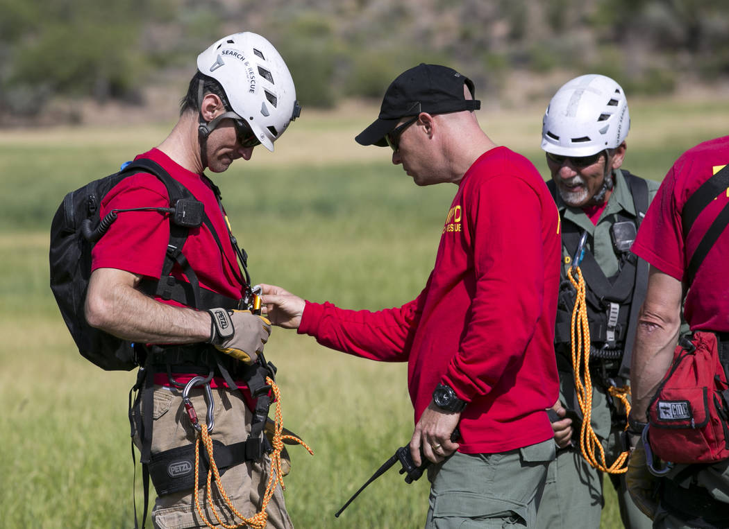 Officers and volunteers from the Metro Search and Rescue team prepare to perform a rescue demonstration Friends Of Metro Search & Rescue 5K Fun Run at Spring Mountain Ranch State Park in Blue  ...
