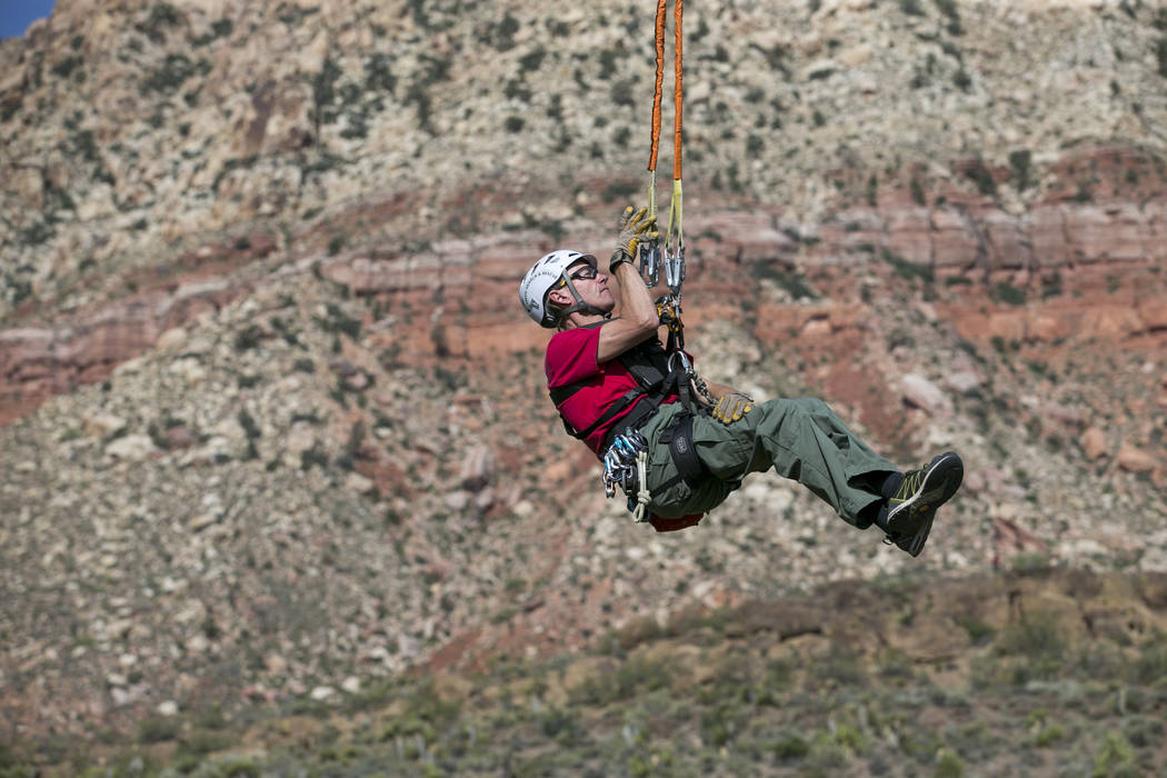Officers and volunteers from the Metro Search and Rescue team perform a rescue demonstration during the Friends of Metro Search & Rescue 5K Fun Run at Spring Mountain Ranch State Park in Blue  ...