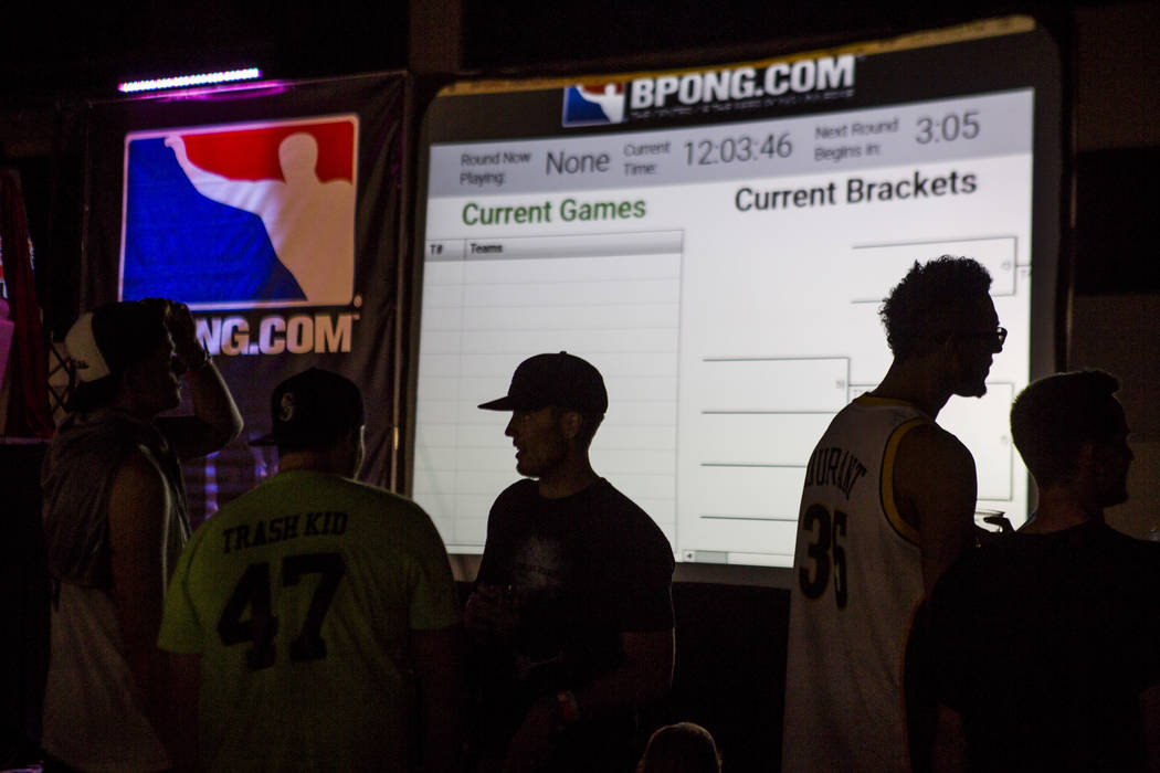 Pong players are silhouetted by a screen displaying brackets during the World Series of Beer Pong at the Westgate Las Vegas on Sunday, June 4, 2017. Patrick Connolly Las Vegas Review-Journal @PConnPie