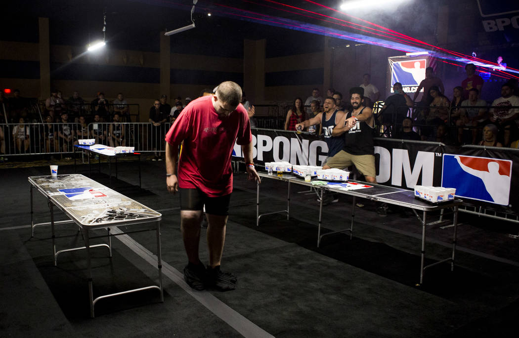 Vince Catizone and Thomas Reap laugh in the background after Reap pulled Brandon Marx's pants down during the World Series of Beer Pong trick shot contest at the Westgate Las Vegas on Sunday, June ...