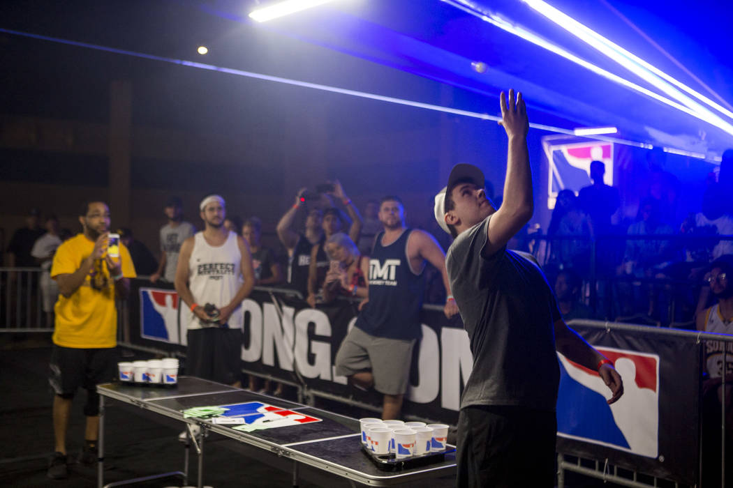 Andrew Borys attempts a backwards shot during the World Series of Beer Pong trick shot contest at the Westgate Las Vegas on Sunday, June 4, 2017. Patrick Connolly Las Vegas Review-Journal @PConnPie