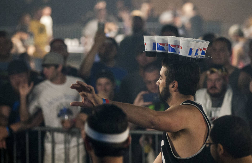 Thomas Reap attempts a shot with an entire rack of cups on his head during the World Series of Beer Pong trick shot contest at the Westgate Las Vegas on Sunday, June 4, 2017. Patrick Connolly Las  ...