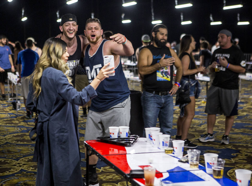 Vince Catizone, center, reacts with a friend for a Snapchat video during the World Series of Beer Pong at the Westgate Las Vegas on Sunday, June 4, 2017. Patrick Connolly Las Vegas Review-Journal  ...