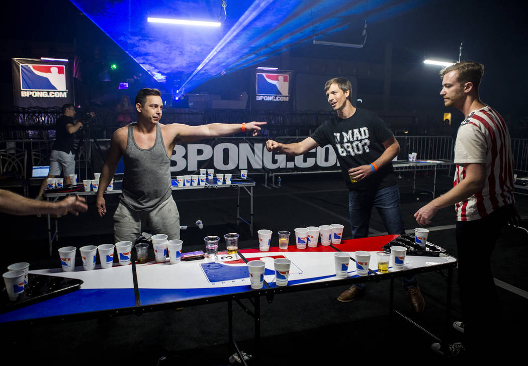 Justin Costa, left, and Sean Bachelder fist bump after Costa's team won a round during the World Series of Beer Pong at the Westgate Las Vegas on Sunday, June 4, 2017. Patrick Connolly Las Vegas R ...