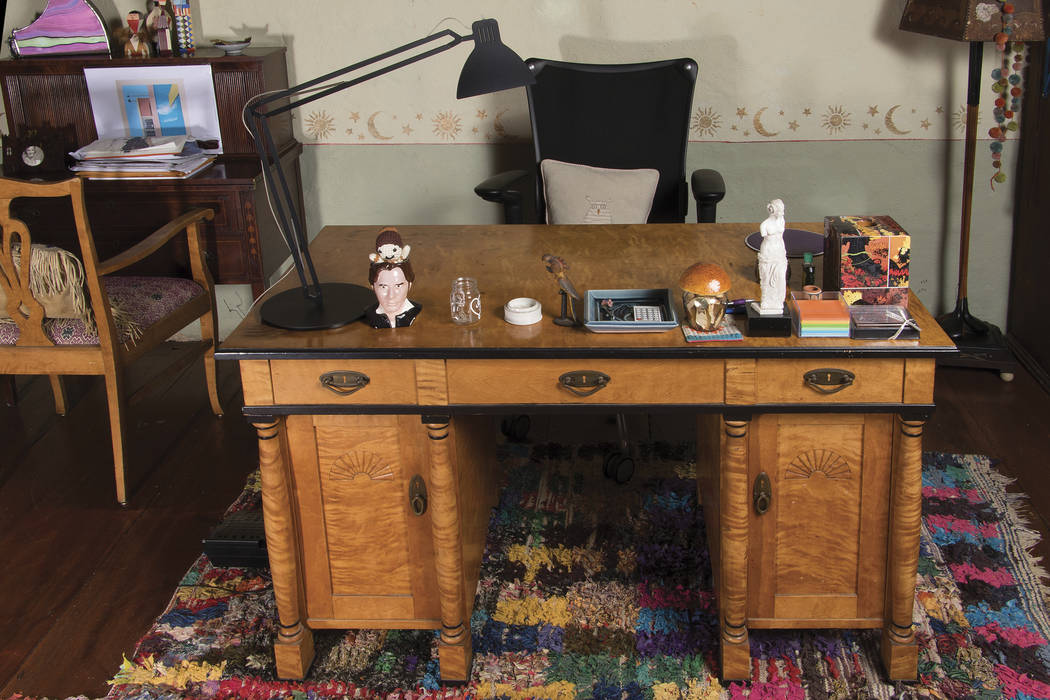 This image re;eased by Profiles in History shows a Biedermeier-style writing desk with faux drawer and cabinet front, belonging to the late actress Carrie Fisher. The desk is among many items belo ...