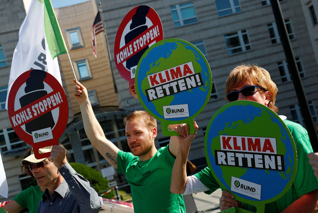 "Environmental activists of BUND protest in front of the U.S. embassy against the U.S. withdrawal from the Paris climate change deal in Berlin, Germany  June 1, 2017. The banners read ""Pro ..."