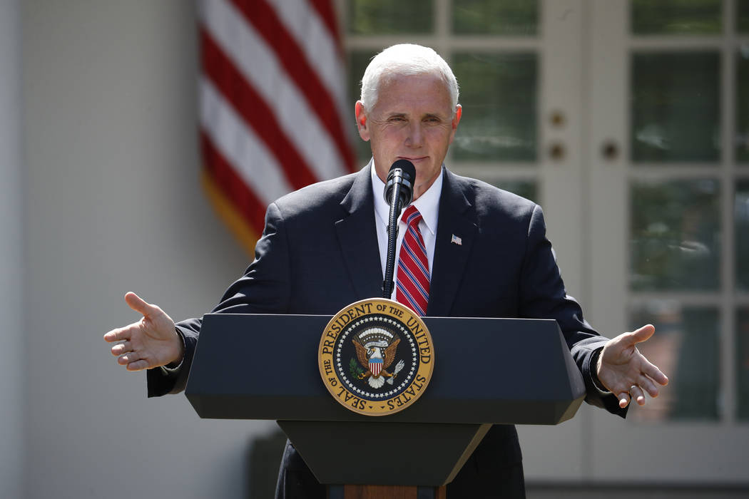 Vice President Mike Pence speaks before President Donald Trump, about the U.S. role in the Paris climate change accord, Thursday, June 1, 2017, in the Rose Garden of the White House in Washington. ...