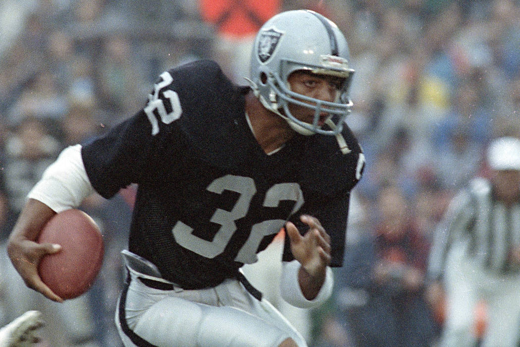 L.A. Raiders' Marcus Allen is seen in action, 1983. (AP Photo)