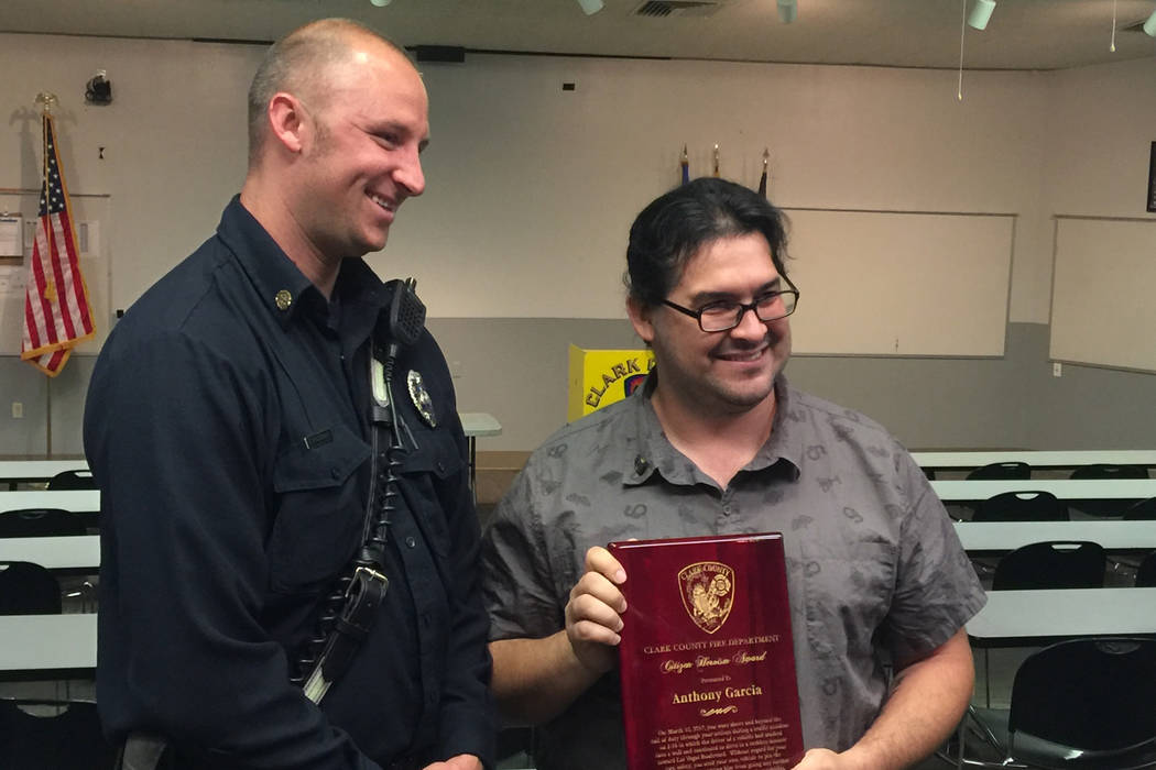 Clark County Fire Department engineer Travis Haldeman, left, nominated Anthony Garcia for the agency's Citizen Heroism Award after the Las Vegas man stopped an out-of-control vehicle near the Stri ...