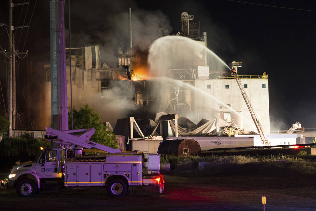 In this photo provided by Jeff Lange, firefighters work the scene following an explosion and fire at the Didion Milling plant in Cambria, Wis., Thursday, June 1, 2017. Recovery crews searched a mo ...