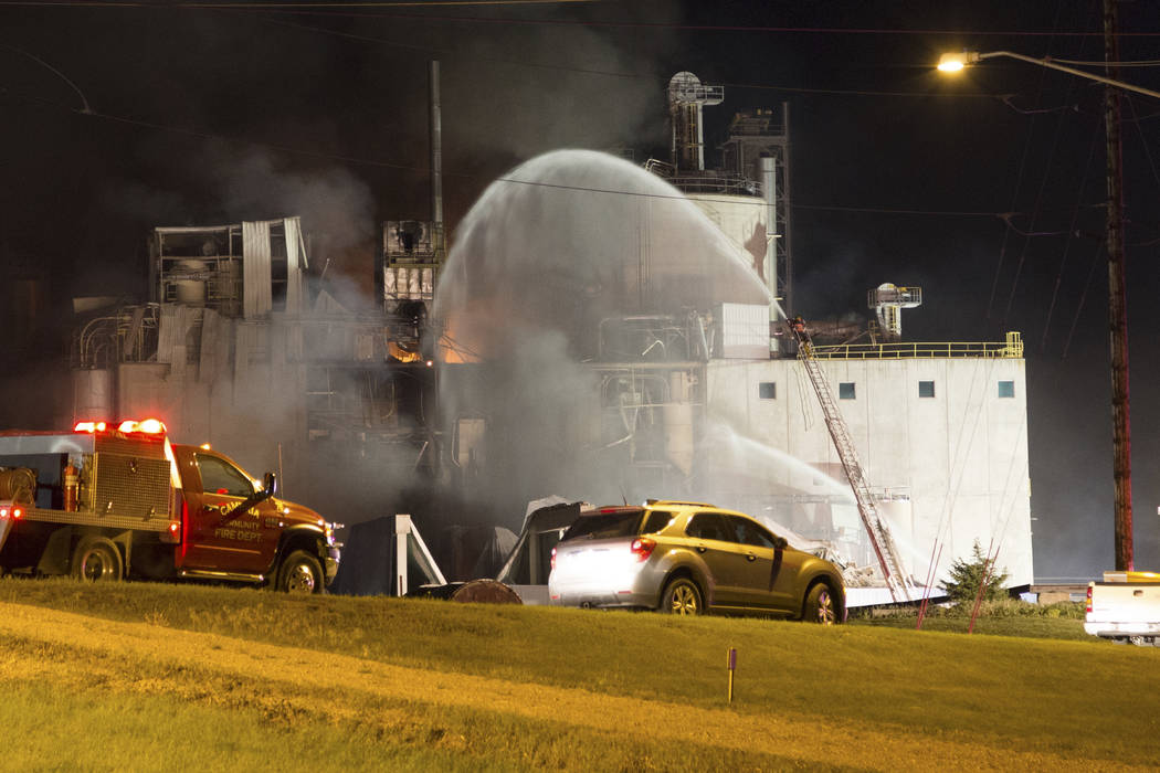 This Thursday, June 1, 2017, photo provided by Jeff Lange shows firefighters at the scene following an explosion and fire at the Didion Milling plant in Cambria, Wis. Recovery crews searched a mou ...