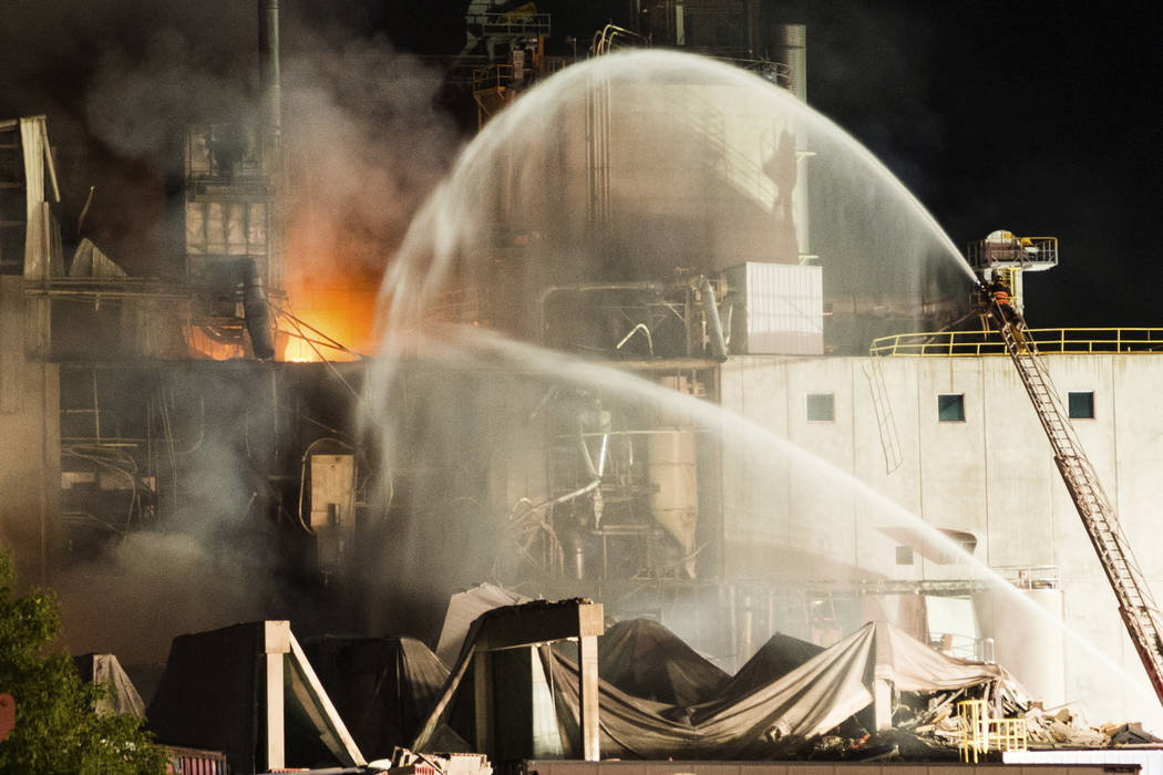 In this photo provided by Jeff Lange, firefighters work at the scene following an explosion and fire at the Didion Milling plant in Cambria, Wis., Thursday, June 1, 2017. Recovery crews searched a ...