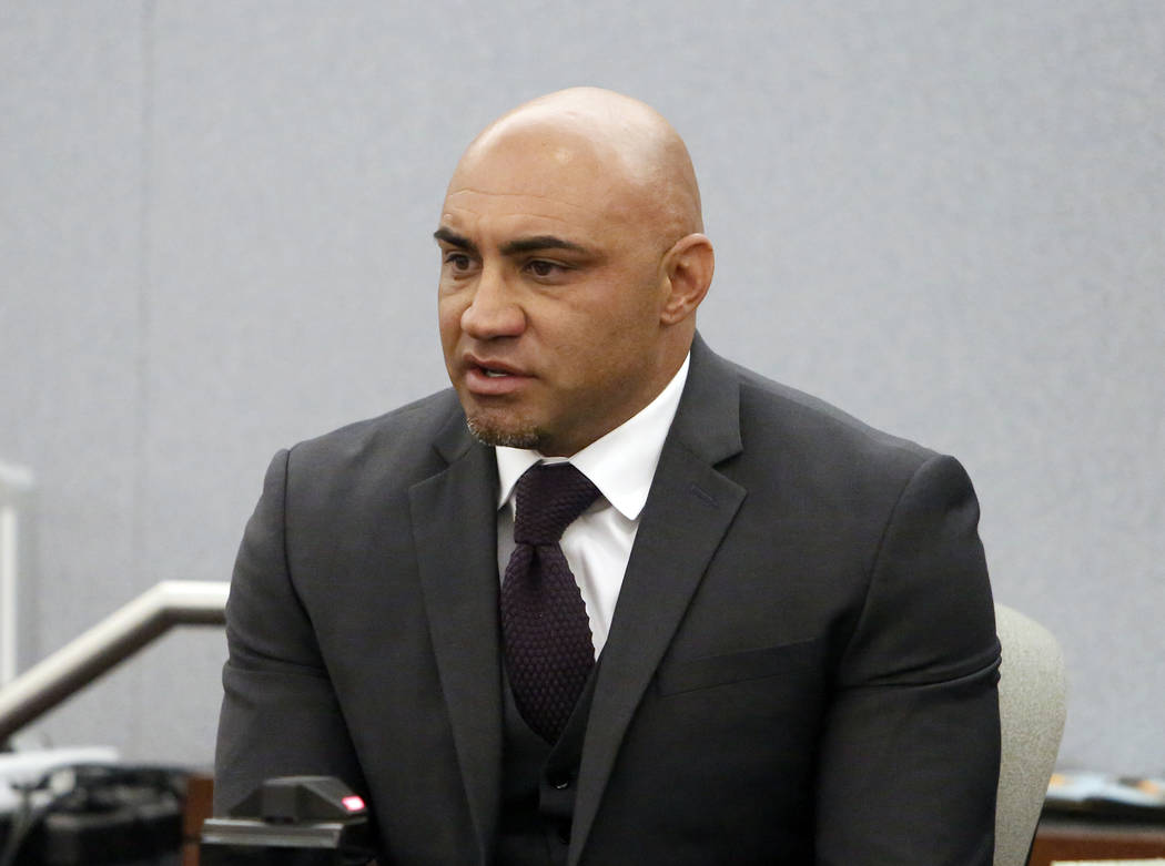Kenny Sanchez, Bishop Gorman's head football coach charged with domestic violence against his ex-fiancee, takes the witness stand at the Regional Justice Center on Tuesday, May 30, 2017, in Las Ve ...